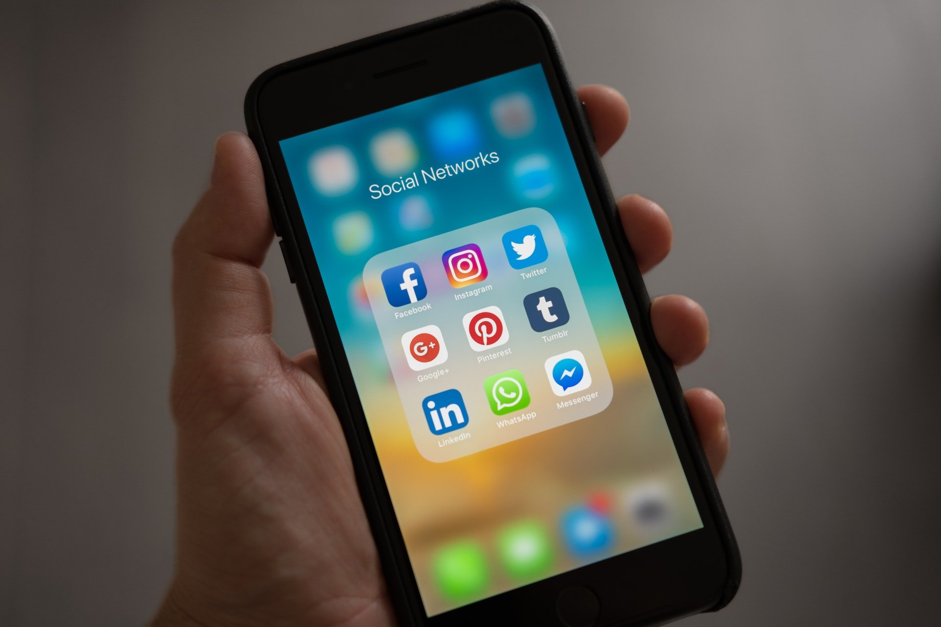 Photo of a person gabbing a phone to illustrate social media engagement.